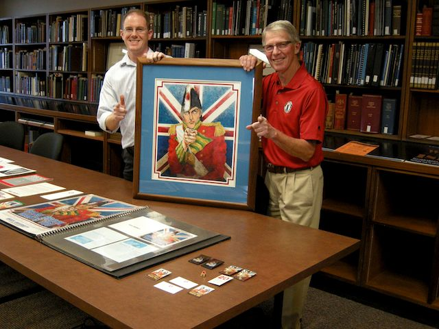 David Sharron, Brock Archivist and Doug Geddie hold the original artwork used in the Isaac Brock Wants You recruitment campaign.
